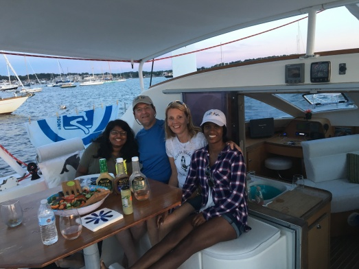 Enjoying some food on deck during a charter sail in Newport