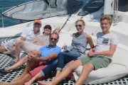 Relaxing on the trampoline of our catamaran charter