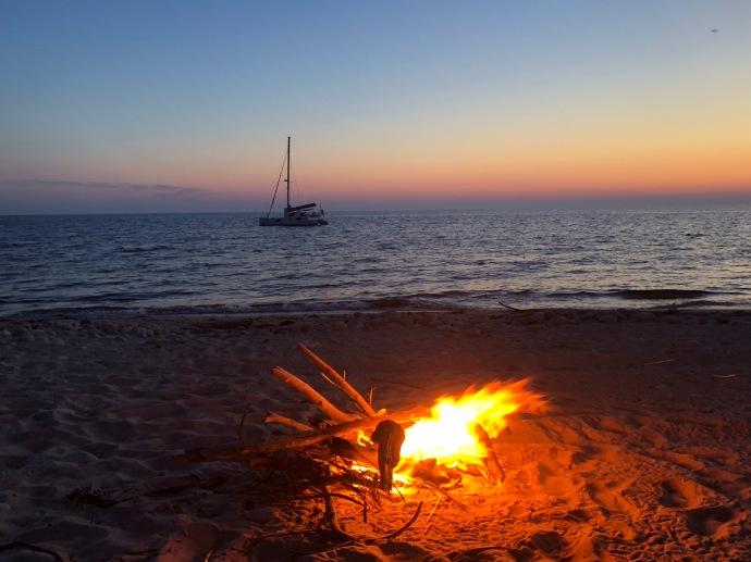Boat at anchor. Beach bonfire