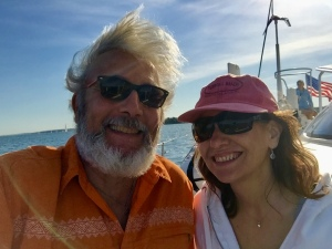 Happy couple on catamaran