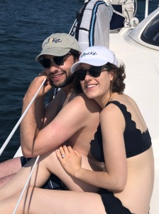 Newly engaged enjoying their catamaran sail