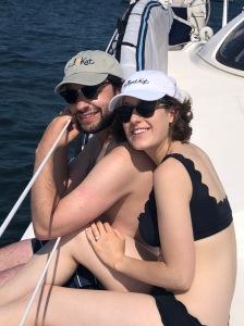 Newly engaged enjoying their catamaran sail