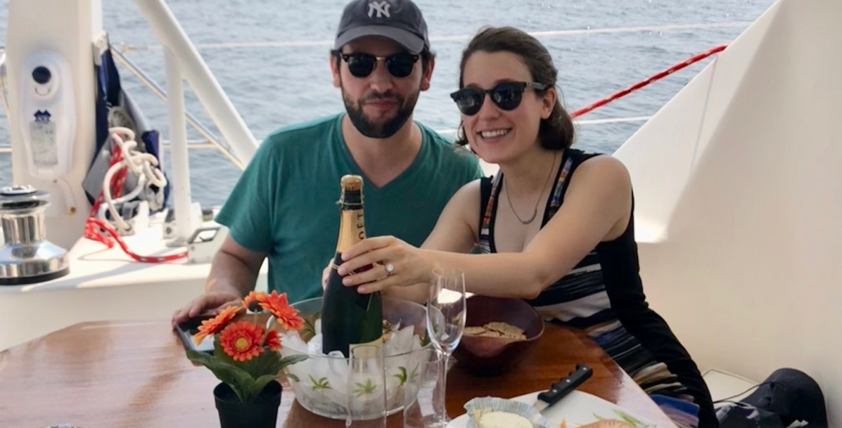 Engagement champagne on catamaran