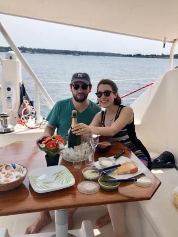 Engagement champagne on catamaran