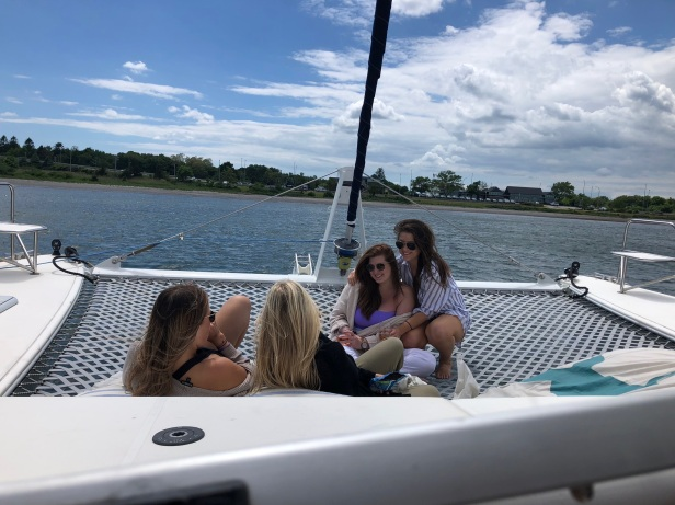 Four friends on a catamaran