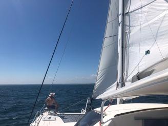 Man on the catamaran bow seat