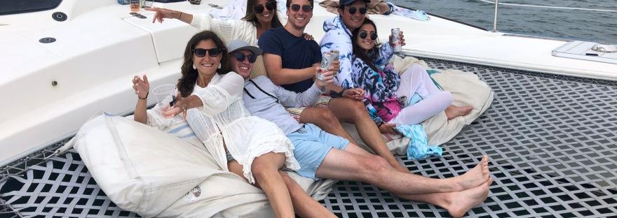 Friends on catamaran charter