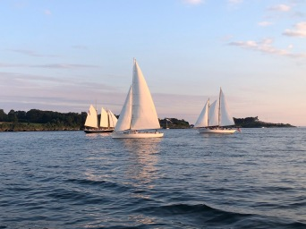 Crowded sunset sail